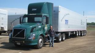 Scott Verspeeten pictured with one of the fleet's new lightweight aluminum trash trailers designed by Titan Trailer.