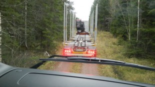 The view from the passenger's seat while riding along with a timber trucker on a Swedish logging road.