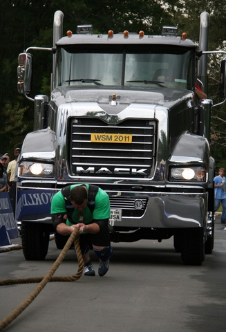 A competitor pulls a Mack Titan during The Met-Rx World's Strongest Man competition in Charlotte, N.C.
