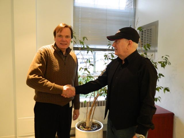 Truck News publisher Rob Wilkins (left) agrees to a deal with Alexis Broadcasting co-owner Stan Campbell to promote and produce a new radio program called Trucker Radio.