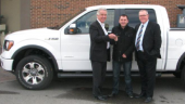 """Yanke driver Sasa Gavranovic (centre) is presented with the keys to his new Ford F-150 by Yanke president and CEO Russel Marcoux (left), and company v.p. Craig Bailey. Gavranovic won the truck as part of Yanke's """"Be the One"""" safety program."""