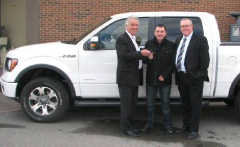 "Yanke driver Sasa Gavranovic (centre) is presented with the keys to his new Ford F-150 by Yanke president and CEO Russel Marcoux (left), and company v.p. Craig Bailey. Gavranovic won the truck as part of Yanke's ""Be the One"" safety program."