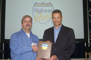 2011 Goodyear North America Highway Hero Award winner Mike Schiotis (left), with Mark Pillow, director of business solutions, Goodyear Commercial Tire Systems. Schiotis, who saved a woman from a gun-wielding attacker, received the award at the Mid-America Trucking Show in Louisville, Ky.