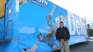Larry Harris, president of RP Oil, stands beside the Delo Truck during its appearance at his location in Whitby, Ont.