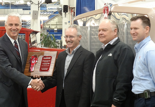 The historic 250,000th Kenworth T800 was received by Trican Well Service during a special ceremony held at the Kenworth assembly plant in Renton, Wash. From left are Gary Moore, Kenworth general manager and PACCAR vice-president; Trican's Don Luft, president and chief operating officer; and Ben Mikulski, corporate manager of equipment standards and R&M services; and Daryl Simon, Kenworth - Renton plant manger.