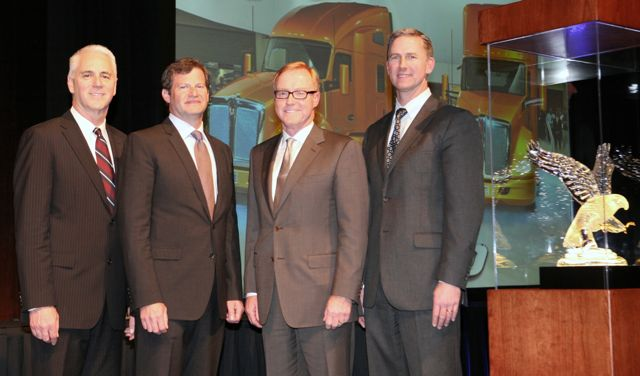 Edmonton Kenworth is honored with the 2011 Kenworth Dealer of the Year Award. From left are Gary Moore, Kenworth general manager; Edmonton Kenworth executives Collin Ferguson and Gary M. King; and Preston Feight, Kenworth assistant general manager - marketing and sales.