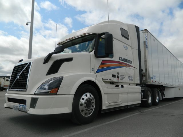 A Volvo VN with Challenger's new logo. The striping no longer covers the hood, saving about $400 per truck and also reducing the cost of hood repairs.