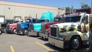 Trucks that took part in the convoy gathered in a NE Calgary parking lot, where drivers gathered to reflect on the loss of their friend Wes Brooks.