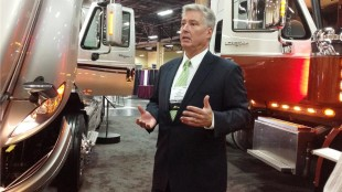 Navistar's Steve Gilligan at ATA conference and trade show explaining company plans to move ahead with SCR engine technology starting in January.