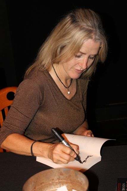 Author Annie Wilder signs a copy of her new book Trucker Ghost Stories.