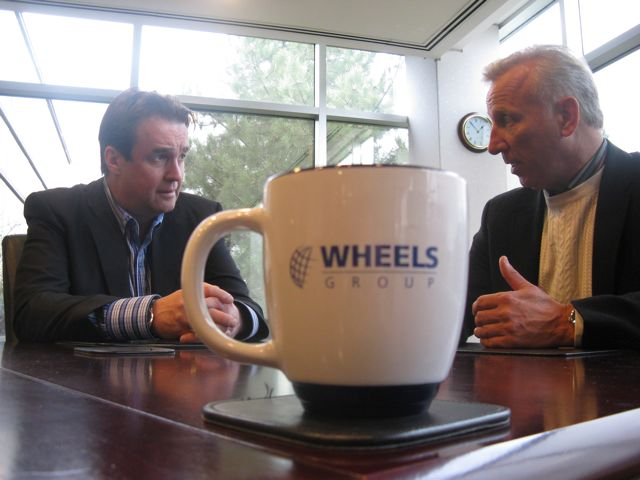 Mike McCarron (left) and Wheels Group CEO Doug Tozer talk about the deal.
