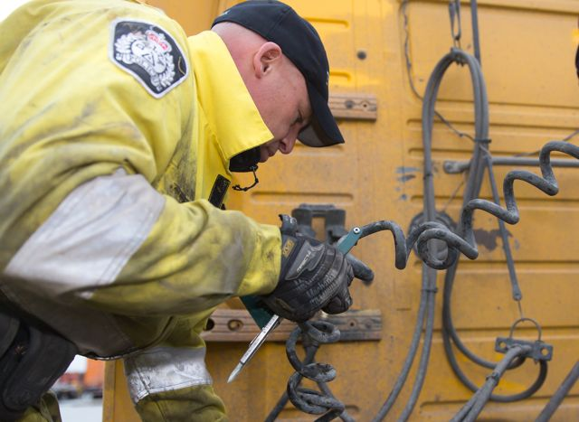 Const. Ken Usipiuk inspects a truck at Harbour Link Container Services' facility in Delta, B.C. Photo by The Delta Optimist.