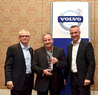 Expressway Trucks dealer principal Scott Lawson (center) receives the 2012 Canada Dealer of the Year award from (left) Terry Billings, Volvo Trucks vice-president, business development and (right) Gran Nyberg, president, Volvo Trucks North American Sales and Marketing.