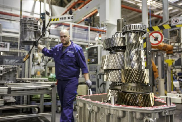 A Daimler plant employee helps manufacture a Detroit DT12 transmission at the company's Gaggenau, Germany facility.