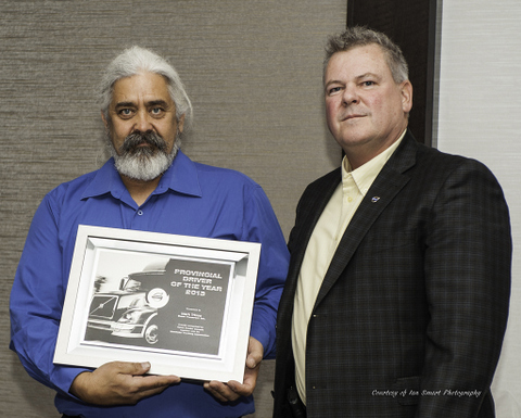 Manitoba's Driver of the Year Mark Tricco (left) was presented the honour, in part, for boasting two million accident-free miles in his career.