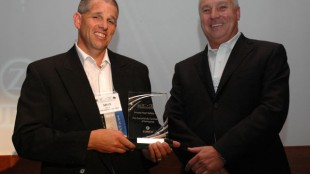 Mike Millian of Hensall District Co-op (left) accepts a PMTC-Zurich Private Fleet Safety Award for most improved safety record.