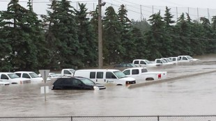 Flooding partially submerged vehicles at Lafarge in Calgary.