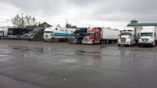 Truckers wait out the rains at the Road King Truck Stop.