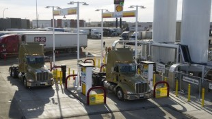 Two LNG-fuelled Bison Transport trucks are parked at the fuel island at Shell's first commercial LNG filling station.