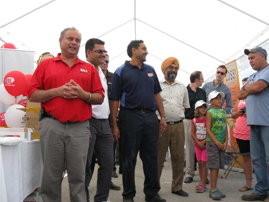 As part of Quick Truck Lube's annual barbeque, company owner Gurjinder Johal (far left) doled out a number of awards to its customers, suppliers, employees and other industry partners.