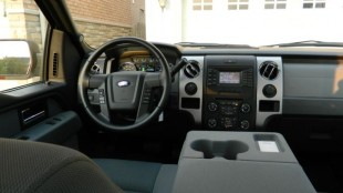 An interior shot of the F-150, including 'The Kitchen Table' console, providing a large work area.