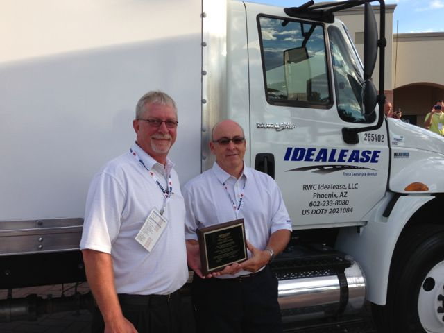 Roadranger representatives Jay Riley (left) and Rick Eckert accepted an award on behalf of Eaton, as the top supplier to Idealease.