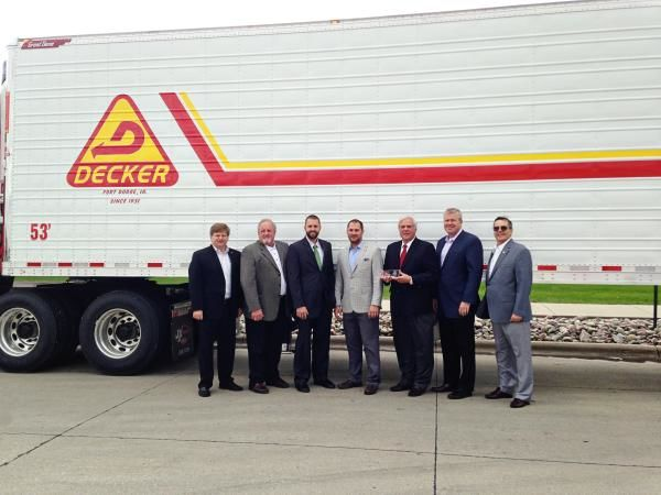 Great Dane recently built the 100,000th trailer out of its Wayne, Nebraska plant. Pictured (L-R): Chris Hammond, Great Dane Vice President of Dealer and International Sales; Darv Habben, Crossroads Trailer President; Mark Habben, Crossroads Trailer; Dale Decker, Decker Truck Line Vice President; Don Decker, President and CEO of Decker Truck Line; Dean Engelage, Great Dane President; Terry Hanson, Great Dane Wayne Plant Manager.