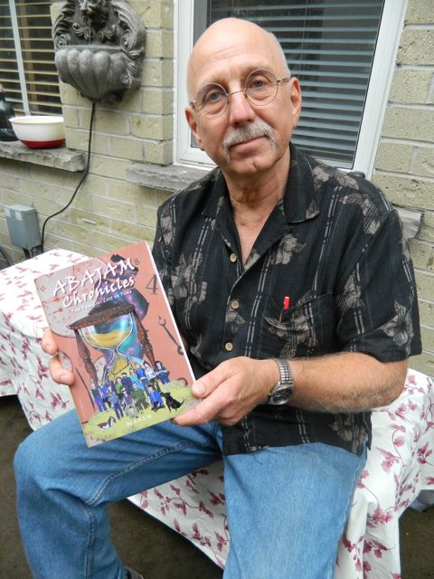 Alfy Meyer pictured with a copy of Abajam Chronicles: Two Families Lost in Time.