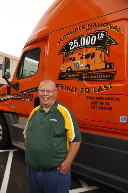 Driver Mike Darras is pictured with his new ride, the 25,000th Freightliner Schneider National has received.