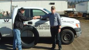 Geoff Danish (right) won a set of Goodyear trailer tires from Sid Floyd of Columbia Truck & Tire in Castlegar, B.C.