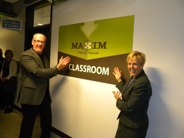 Maxim's Doug Harvey is pictured with Stephanie Forsyth of Red River College. A classroom has been named in Maxim Truck & Trailer's honour, after it made a $100,000 donation to the facility.