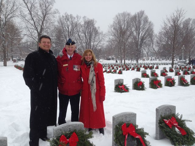 From left-to-right: Rob Penner, Craig McPhee and Kathy Penner lay wreaths at the Beechwood National Cemetery.