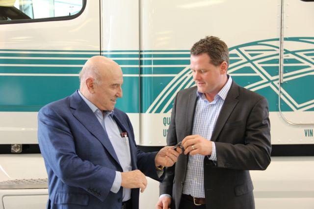 Peterbilt's Matt Preston hands the keys of this Pete 579 to TransX president Louie Tolaini.