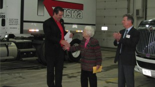 Mississauga mayor Hazel McCallion (centre) congratulations Kriska president Mark Seymour(left) on 35 years in business. Canadian Trucking Alliance president and CEO David Bradley (left) takes part in the ceremony.