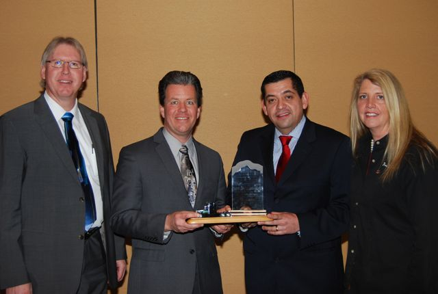 WABCO Reman Solutions was named the Heavy Duty Remanufacturer of the Year award winner by the Heavy Duty Remanufacturing Group (HDRG). Accepting the Award from Sandra Standley, right, chairman of HDRG, is a team from WABCO Reman Solutions, including (left to right) Joe Kripli, Global Business Development Leader; Jeffrey Stukenborg, Chief Engineer; and Salvador Munoz, Reman Business Leader.
