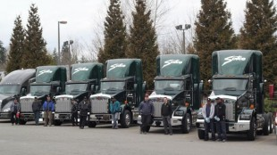 Sutco drivers proudly show off their new rides, six LNG-powered Kenworth trucks.