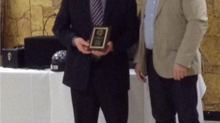 Wayne Jantzi receive an award for 35 years of collision-free driving from Dennis Shantz of Home Hardware.