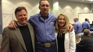 Tim Horton with the parents of the teen he saved.