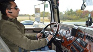 Athwal behind the wheel of his Western Star while making a delivery.