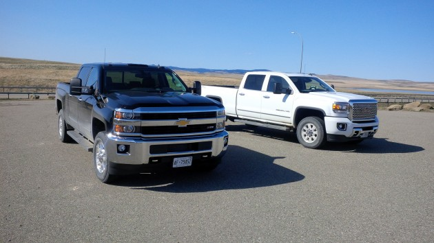 The GMC Sierra HD (left) pictured with its sibling the Chevy Silverado HD.