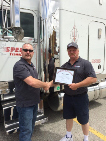 Greg Flear is recognized following his championship run at the Toronto Regional Truck Driving Championships.