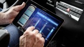 A driver can use an integrated tablet to book parking spots or make restaurant reservations while driving.