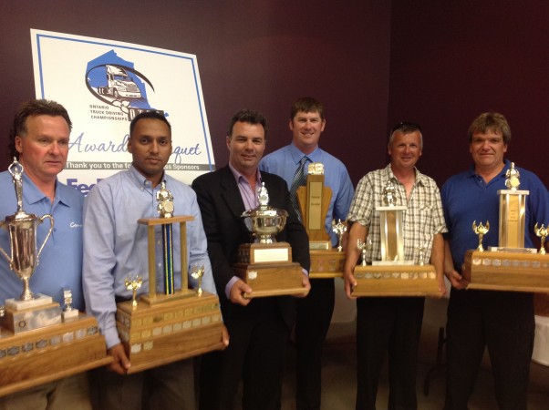 Winners of the 2014 Ontario Truck Driving Championships from left to right: Clary Ward (single-single), Preetpal Nijjar (tandem-tandem), Bruce Lambert (rookie of the year), Aaron Kershaw (B-train), Kerry Ellsworth (single-tandem) and Stew Jutzi (straight truck and grand champion)