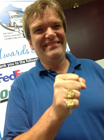 Stew Jutzi displays his two Ontario grand champion rings.