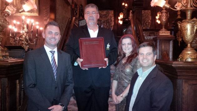 Sponsors Ryan Weary, Castrol (L-R), Danijela Franco, Mack Trucks and Brad Houle, Goodyear, congratulate Sutherland.