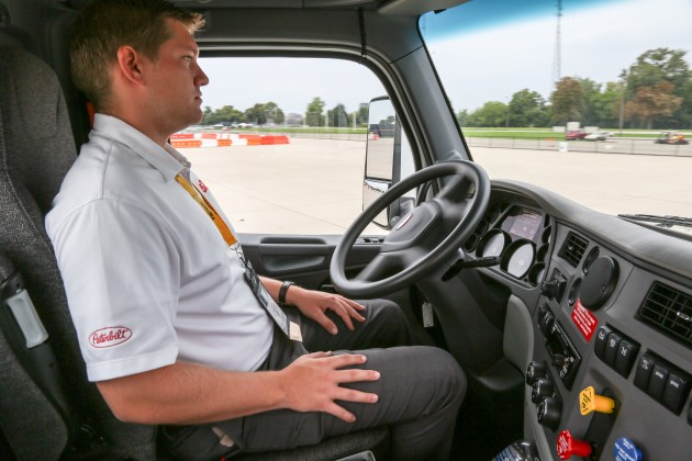 A Peterbilt forgoes driver input and uses GPS to navigate around an obstacle course.