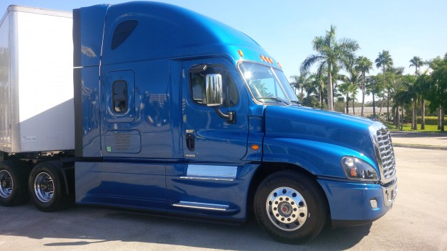 A 2015 Freightliner Cascadia Evolution with Detroit Assurance.