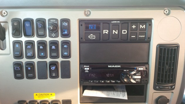 The mDrive console sits in the dash. Exposed screws provide easy access to the wiring behind.