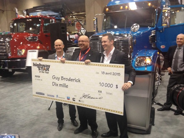 Guy Broderick (middle) receives a $10,000 cheque from Newcom's Joe Glionna (right) and Apps Transport v.p. Scott Casson.