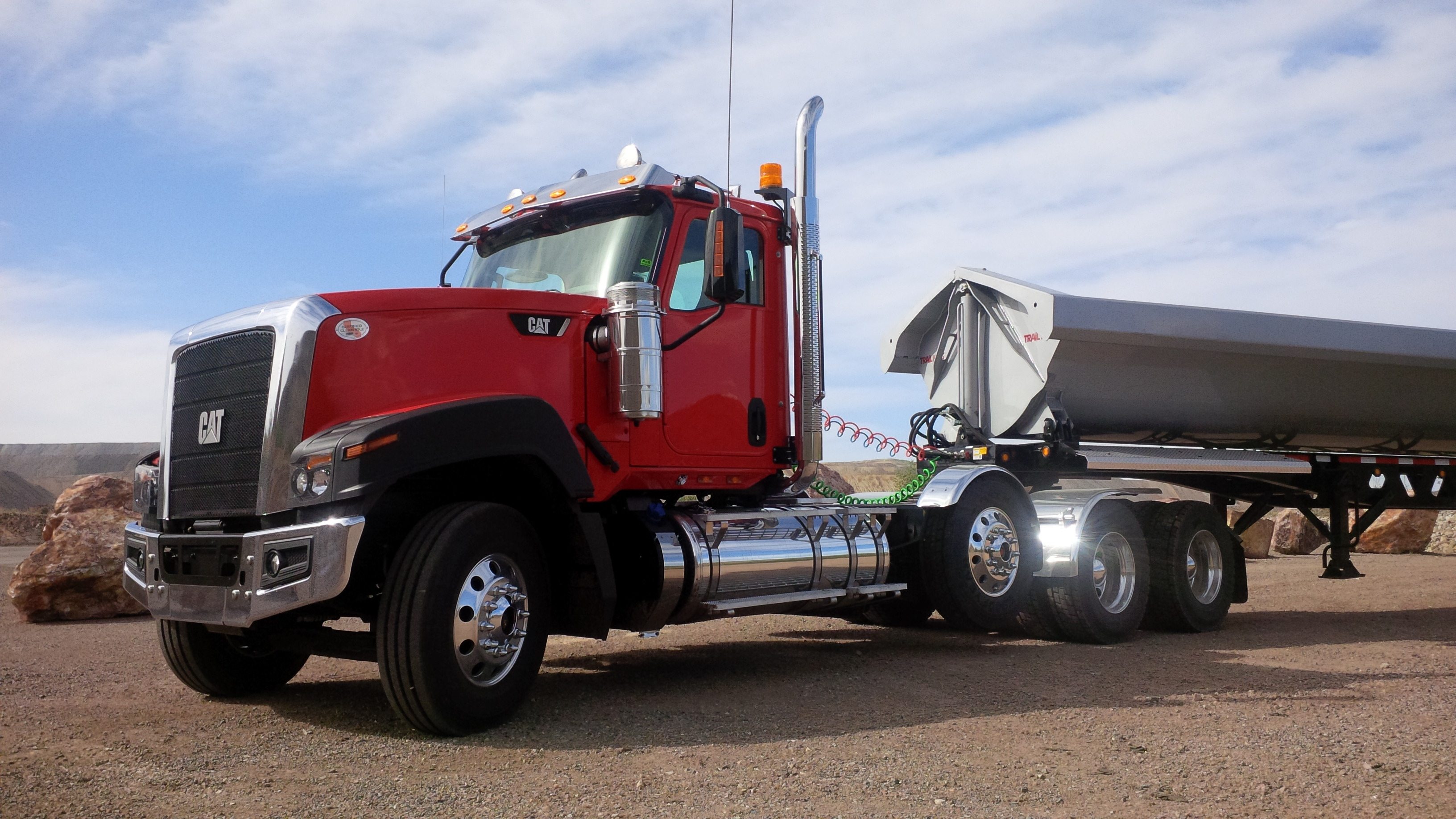 We drove this Cat CT680 with 28 tonnes of boulders in the Trail King trailer .